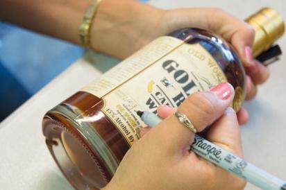 bottle of Old World Spirits whiskey