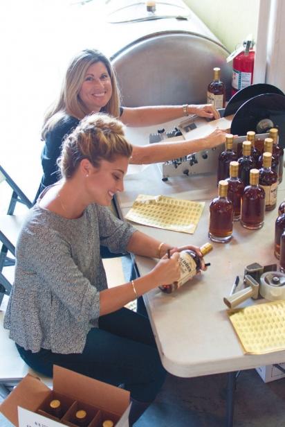 bottle labeling process at distillery Old World Spirits