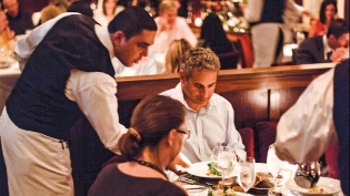 waiter serving hungry guests